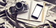 Blank cell phone screen with old style camera, diary and book, m